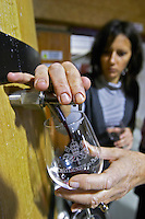 syrah taking a tank sample marie giraud domaine giraud chateauneuf du pape rhone france