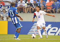Jairo Arrieta (22) of Costa RIca goes against Nery Medina (13) of Honduras.  Honduras defeated Costa Rica 1-0 at the quaterfinal game of the Concacaf Gold Cup, M&T Stadium, Sunday July 21 , 2013.