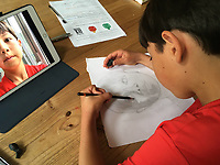 BNPS.co.uk (01202 558833)<br /> Pic: SimoneGreenfield/BNPS<br /> <br /> Video download link: https://we.tl/t-bJLf5479nt<br /> <br /> Pictured: Lucas drawing a self-portrait.<br /> <br /> A nine-year-old artist described as an 'outstanding' talent will have his work exhibited by the Royal Academy.<br /> <br /> Lucas Greenfield began drawing life-like portraits of his favourite footballers during the first lockdown.<br /> <br /> His parents were amazed by the sudden out-pour of work which followed, including pictures of pets commissioned and paid for by his teachers.