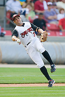 Third baseman Jake Kahaulelio #3 of the Carolina Mudcats makes an off balance throw to first base against the Jacksonville Suns at Five County Stadium May 15, 2010, in Zebulon, North Carolina.  Photo by Brian Westerholt /  Seam Images