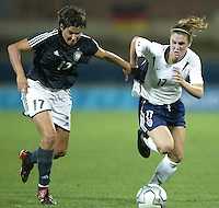 23 August 2004:   Heather O'Reilly fights for the ball against Ariane Hingst of Germany during the semifinal game at Pankritio Stadium in Heraklio, Greece.     USA defeated Germany, 2-1 in overtime.   Credit: Michael Pimentel / ISI