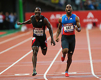 06 JUL 2012 - PARIS, FRA - Tyson Gay of the USA (right) beats Justin Gatlin of the USA (left to the finish line to win the men's 100m race at the 2012 Meeting Areva held in the Stade de France in Paris, France .(PHOTO (C) 2012 NIGEL FARROW)