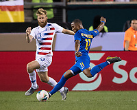 PHILADELPHIA, PA - JUNE 30: Gevaro Nepomuceno #11 drives the ball past Tim Ream #13 during a game between Curaçao and USMNT at Lincoln Financial Field on June 30, 2019 in Philadelphia, Pennsylvania.
