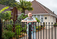 BNPS.co.uk (01202) 558833. <br /> Pic: CorinMesser/BNPS<br /> <br /> Pictured: Mike Clifford in his exotic garden. <br /> <br /> A gardener who spent years cultivating some of the world's rarest plants is opening his exotic bungalow garden for charity. <br /> <br /> Mobile home designer, Mike Clifford, began tropical gardening over 20 years ago when he was inspired by a documentary on the subject.  <br /> <br /> Since then, he and his wife Tina, who makes cakes for visitors, have cultivated thousands of plants from across the globe in their quaint English garden.