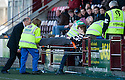 Rhys Devlin gets carried off after injuring his knee ...