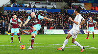 James Collins of West Ham United has a shot on goal during the Barclays Premier League match between Swansea City and West Ham United played at The Liberty Stadium, Swansea on 20th December 2015
