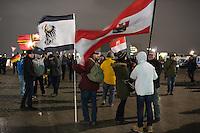 """Nachdem an drei voran gegangenen Baergida-Aufmaerschen mehrere hundert Menschen teilgenommen haben, kamen am Montag den 26. Januar 2015 nur noch ca. 150 Personen. Wieder nahmen viele militante Neonazis aus Berlin und Brandenburg, Hooligans, sog. """"Reichsbuerger"""" teil.<br /> Im Bild: Einer der Veranstaltungsteilnehmer kam mit der Flagge des Koenigreich Preussen von 1892 bis 1918.<br /> 26.1.2015, Berlin<br /> Copyright: Christian-Ditsch.de<br /> [Inhaltsveraendernde Manipulation des Fotos nur nach ausdruecklicher Genehmigung des Fotografen. Vereinbarungen ueber Abtretung von Persoenlichkeitsrechten/Model Release der abgebildeten Person/Personen liegen nicht vor. NO MODEL RELEASE! Nur fuer Redaktionelle Zwecke. Don't publish without copyright Christian-Ditsch.de, Veroeffentlichung nur mit Fotografennennung, sowie gegen Honorar, MwSt. und Beleg. Konto: I N G - D i B a, IBAN DE58500105175400192269, BIC INGDDEFFXXX, Kontakt: post@christian-ditsch.de<br /> Bei der Bearbeitung der Dateiinformationen darf die Urheberkennzeichnung in den EXIF- und  IPTC-Daten nicht entfernt werden, diese sind in digitalen Medien nach §95c UrhG rechtlich geschuetzt. Der Urhebervermerk wird gemaess §13 UrhG verlangt.]"""