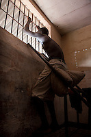16 year old Maju Daramy looks through the bars of the window of his cell in Pademba Central Prison. He received a 3 year sentence for stealing a phone, a charge he denies.