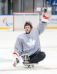 Sochi, RUSSIA - Mar 2 2014 -  Benoit St-Amand calls for his water bottle during practice before the 2014 Paralympics in Sochi, Russia.  (Photo: Matthew Murnaghan/Canadian Paralympic Committee)