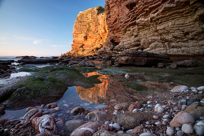 Evening light shines on seashore cliffs in the domaine d'Abbadie in the Basque country on the Atlantic coast of France on Oct. 5, 2014.