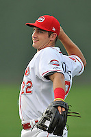 Third baseman Mitchell Gunsolus (22) of the Greenville Drive warms up before a game against the Charleston RiverDogs on Tuesday, May 17, 2016, at Fluor Field at the West End in Greenville, South Carolina. Greenville won, 4-2. (Tom Priddy/Four Seam Images)