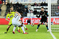 Luciano Narsingh of Swansea City (C) fails to score while challenged by Carl Dickinson of Notts County (L) rduring The Emirates FA Cup match between Swansea City and Notts County at The Liberty Stadium, Swansea, Wales, UK. Tuesday 06 February 2018