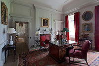 Lord Dumfries's study, furnished with a large Turkish rug and antique desk