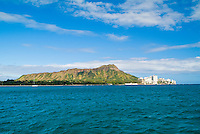 The magnificent full length of Diamond Head with  a wide expanse of beautiful blue ocean as seen from a sailboat.