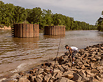 May 4, 2018. Fayetteville, North Carolina.<br /> <br /> D'Anthony Brown sets up fishing poles at the William O Huske Dam. This is the dam closest to the Chemours plant.<br /> <br /> The Chemours Company, a spin off from DuPont, manufactures many chemicals at its plant in Fayetteville, NC. One of these, commonly referred to as GenX, is part of the process of teflon manufacturing. Chemours has been accused of dumping large quantities of GenX into the Cape Fear River and polluting the water supply of city's down river and allowing GenX to leak into local aquifers.