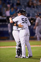 Tampa Yankees relief pitcher Caleb Frare (58) and catcher Santiago Nessy (19) congratulate each other after a game against the Lakeland Flying Tigers on April 8, 2016 at George M. Steinbrenner Field in Tampa, Florida.  Tampa defeated Lakeland 7-1.  (Mike Janes/Four Seam Images)