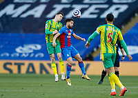 10/13th March 2021; Selhurst Park, London, England; English Premier League Football, Crystal Palace versus West Bromwich Albion; Conor Townsend of West Bromwich Albion heads the ball out above Andros Townsend of Crystal Palace