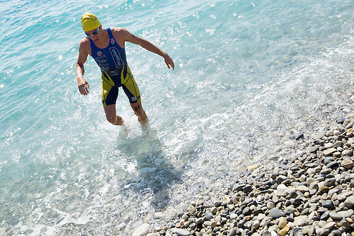 16 SEP 2012 - NICE, FRA - Nicholas Alliot of Saint Jean de Monts Vendee Triathlon leaves the water after a warm up swim before the start of the French Grand Prix triathlon series final stage held during the Triathlon de Nice Côte d'Azur (PHOTO (C) 2012 NIGEL FARROW)