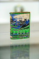 BNPS.co.uk (01202 558833)<br /> Pic: MaxWillcock/BNPS<br /> <br /> Pictured: The first-impression copy of The Hobbit, in the saleroom at Duke's in Dorchester, Dorset.<br /> <br /> A rare first impression edition of Tolkien's classic children's book The Hobbit has sold for a whopping £59,800.<br /> <br /> The sought-after copy was one of the first ever printed and includes original maps and illustrations by the author.  <br /> <br /> It is adorned with a wraparound cloth depicting the iconic dark blue mountains and deep-green forests of Tolkien's fantasy world. <br /> <br /> The family who sold it were completely unaware of its true worth until a valuer visited their home in Dorset and spotted it on a dusty bookshelf.