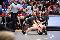 STANFORD, CA - March 7, 2020: Jose Champagne of Little Rock and Logan Meek of Oregon State University during the 2020 Pac-12 Wrestling Championships at Maples Pavilion.