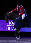 OMAHA, NEBRASKA - APR 2: McLain Ward pats HH Azur during the awards ceremony after winning the Longines FEI World Cup Jumping Final at the CenturyLink Center on April 2, 2017 in Omaha, Nebraska. (Photo by Taylor Pence/Eclipse Sportswire/Getty Images)