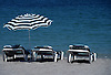three reclining chairs and an umbrella at a sandy beach<br /> <br /> tres hamacas y un parasol en la playa<br /> <br /> drei Sonnenliegen und ein Sonnenschirm am Sandstrand<br /> <br /> 3000 x 2037 px<br /> Original: 35 mm slide transparency