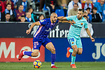 Nourredine Amrabat (l) of CD Leganes fights for the ball with Jordi Alba Ramos of FC Barcelona during the La Liga 2017-18 match between CD Leganes vs FC Barcelona at Estadio Municipal Butarque on November 18 2017 in Leganes, Spain. Photo by Diego Gonzalez / Power Sport Images