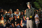 Carson City Sheriff Kenny Furlong speaks at a candlelight vigil after a deputy was killed in the line of duty in Carson City, Nev., on Saturday, Aug. 15, 2015. Hundreds of residents came out to show their support for the family and department.<br /> Photo by Cathleen Allison