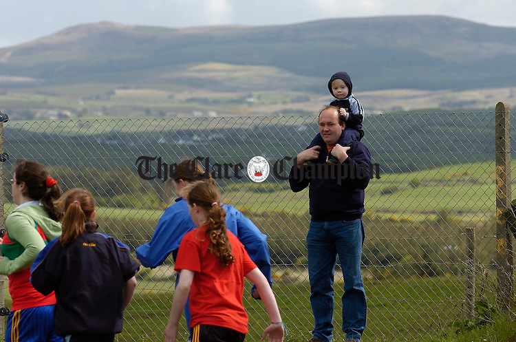 Michael and his son Paul Mc Namara from Cree watching all the action  at the Clare Juvenile Athletics championships in Mullagh. Photograph by John Kelly.