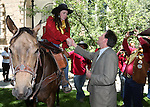 Catie Peralta, of Dayton, talks with Lt. Gov. Brian Krolicki following a brief Sesquicentennial ceremony along the route of the annual Pony Express Re-ride through Carson City, Nev., on Thursday, June 12, 2014. (Las Vegas Review-Journal/Cathleen Allison)