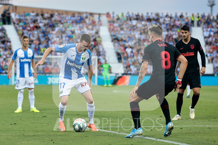 CD Leganes's Javier Eraso and Atletico de Madrid's Saul Niguez during La Liga match between CD Leganes and Atletico de Madrid at Butarque Stadium in Madrid, Spain. August 25, 2019. (ALTERPHOTOS/A. Perez Meca)