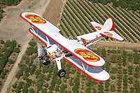 Boeing Stearman Model 75 (S/N 75-603) sponsored by Jelly Belly flies over the Central Valley of California. One of the best known biplanes in aviation over 10 thousand of the model were manufactured for the military as a primary trainer during the Second World War. The Jelly Belly Stearman appears regularly at airshows throughout the western United States.
