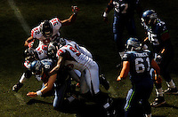 Sep 18, 2005; Seattle, WA, USA; Seattle Seahawks linemen look on as the Atlanta Falcons defense sacks quarterback Matt Hasselbeck #8  in the fourth quarter at Qwest Field. Mandatory Credit: Photo By Mark J. Rebilas