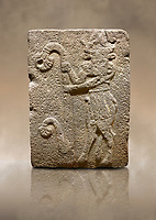 Photo of Hittite monumental relief sculpted orthostat stone panel from Water Gate Basalt, Karkamıs, (Kargamıs), Carchemish (Karkemish), 900-700 B.C. Anatolian Civilisations Museum, Ankara, Turkey. Bull-man holding the trunk of the tree. The waist-down part of the figure is in the form of a bull. <br /> <br /> On a brown art background.