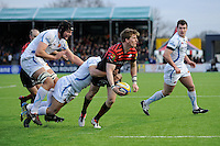 20130216 Copyright onEdition 2013©.Free for editorial use image, please credit: onEdition..David Strettle of Saracens offloads as he is tackled by Phil Dollman of Exeter Chiefs during the Premiership Rugby match between Saracens and Exeter Chiefs at Allianz Park on Saturday 16th February 2013 (Photo by Rob Munro)..For press contacts contact: Sam Feasey at brandRapport on M: +44 (0)7717 757114 E: SFeasey@brand-rapport.com..If you require a higher resolution image or you have any other onEdition photographic enquiries, please contact onEdition on 0845 900 2 900 or email info@onEdition.com.This image is copyright onEdition 2013©..This image has been supplied by onEdition and must be credited onEdition. The author is asserting his full Moral rights in relation to the publication of this image. Rights for onward transmission of any image or file is not granted or implied. Changing or deleting Copyright information is illegal as specified in the Copyright, Design and Patents Act 1988. If you are in any way unsure of your right to publish this image please contact onEdition on 0845 900 2 900 or email info@onEdition.com
