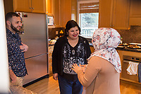 """SEATTLE, WA-APRIL 17, 2017: Amanda Saab, along with her husband Hussein Saab, greet Anjana Agarwal, as she arrives for """"dinner with your Muslim neighbor"""" at the home of Stefanie and Nason (cq) Fox in Seattle, WA on a return trip April 17th 2017. The couple now live in Detroit. <br />   <br /> (Photo by Meryl Schenker/For The Washington Post)"""