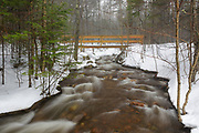 Franconia Notch State Park - Footbridge along the Mount Pemigewasset Trail in the White Mountains of New Hampshire during the winter months.