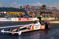 Aug. 4, 2013; Kent, WA, USA: NHRA top fuel dragster driver Clay Millican during the Northwest Nationals at Pacific Raceways. Mandatory Credit: Mark J. Rebilas-USA TODAY Sports