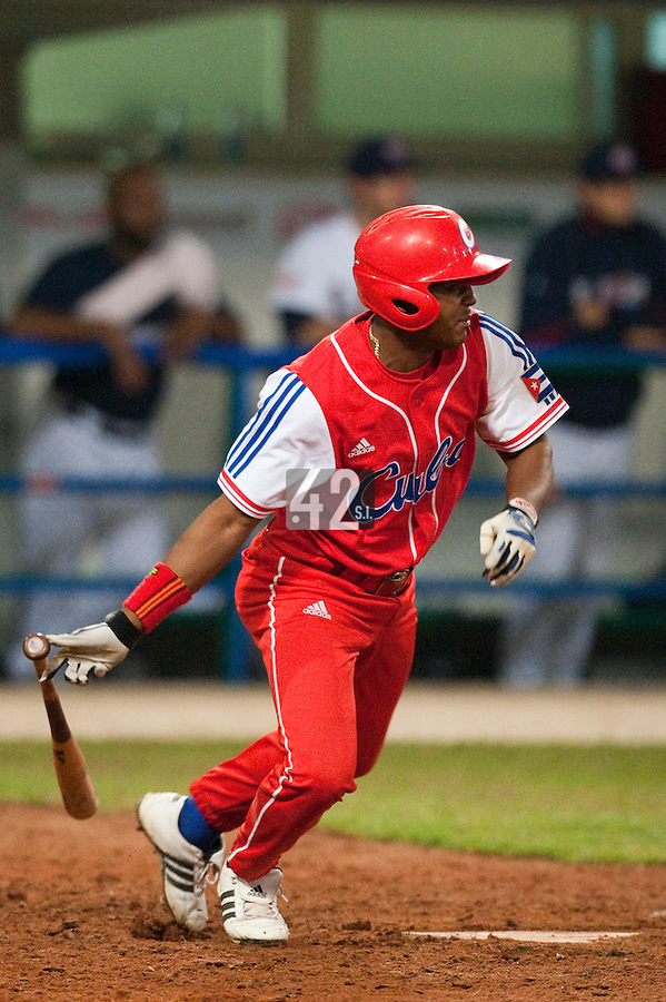 24 September 2009: Giorvis Duvergel of Cuba runs as he hits the ball during the 2009 Baseball World Cup final round match won 5-3 by Team USA over Cuba, in Nettuno, Italy.