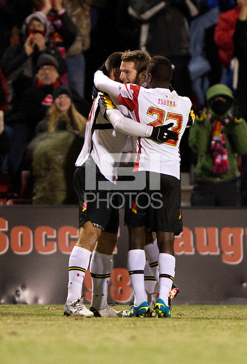 Jake Pace (20) of Maryland celebrates his goal with teammates Suli Dainkeh (22) and Patrick Mullins (15) during the second round of the NCAA tournament at Ludwig Field in College Park, MD.  Maryland defeated Providence, 3-1.