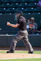Home plate umpire Chase Eade calls a batter out on strikes during the Carolina League game between the Wilmington Blue Rocks and the Winston-Salem Dash at BB&T Ballpark on July 6, 2014 in Winston-Salem, North Carolina.  The Dash defeated the Blue Rocks 7-1.   (Brian Westerholt/Four Seam Images)