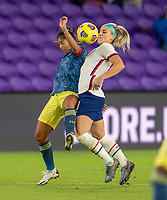 ORLANDO, FL - JANUARY 18: Julie Ertz #8 of the USWNT fights for the ball during a game between Colombia and USWNT at Exploria Stadium on January 18, 2021 in Orlando, Florida.