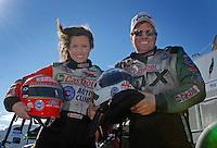 Portrait of NHRA Funny Car driver Ashley Force and her father John Force during preseason testing at The Strip at Las Vegas Motor Speedway in Las Vegas, NV. Mandatory Credit: Mark J. Rebilas