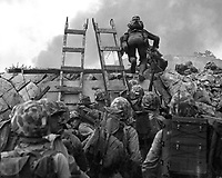 """As against """"The Shores of Tripoli"""" in the Marine Hymn, Leathernecks use scaling ladders to storm ashore at Inchon in amphibious invasion September 15, 1950.  The attack was so swift that casualties were surprisingly low.  S.Sgt. W.W. Frank. (Marine Corps)<br /> NARA FILE #:  127-N-A3191<br /> WAR & CONFLICT BOOK #:  1419"""