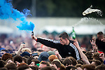 © Joel Goodman - 07973 332324 . 05/06/2015 . Manchester , UK . A man with a flare in the crowd . Evening concerts featuring headliners , The Courteeners , playing a homecoming gig , at Heaton Park in Manchester in front of 25,000 people , the evening before the Parklife music festival . Photo credit : Joel Goodman