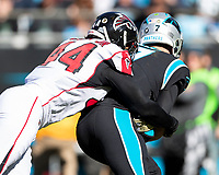 CHARLOTTE, NC - NOVEMBER 17: Kyle Allen #7 of the Carolina Panthers is chased by Vic Beasley #44 of the Atlanta Falcons resulting in a sack during a game between Atlanta Falcons and Carolina Panthers at Bank of America Stadium on November 17, 2019 in Charlotte, North Carolina.