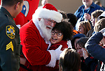 Santa hugs fourth-grader Jaleesia Vaughn as hundreds of students participate in the 15th annual Holiday with a Hero program at Walmart in Carson City, on Wednesday, Dec. 19, 2018. <br /> Photo by Cathleen Allison/Nevada Momentum