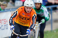 13 SEP 2014 - IPSWICH, GBR - Ricki Johnson (left) from Wednesfield Aces tries to get away from Robert Croal from Exeter Aces during a first semi final heat of the 2014 British Open Club Cycle Speedway Championships at Whitton Sports & Community Centre in Ipswich, Great Britain (PHOTO COPYRIGHT © 2014 NIGEL FARROW, ALL RIGHTS RESERVED)