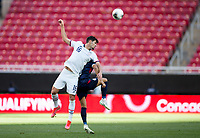 ZAPOPAN, MEXICO - MARCH 21: Johnny Cardoso #16 of the United States jumps high for a head ball during a game between Dominican Republic and USMNT U-23 at Estadio Akron on March 21, 2021 in Zapopan, Mexico.