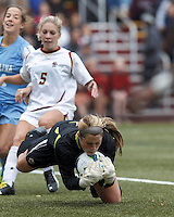 Boston College goalkeeper Alexandra Johnson (0) smothers a shot.  University of North Carolina (blue) defeated Boston College (white), 1-0, at Newton Campus Field, on October 13, 2013.